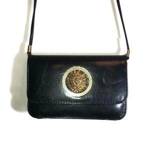 Women's Black Fuax Leather Gold Sun Shoulder Bag.